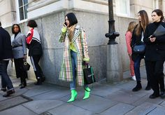 Tiffany Hsu in Burberry coat and scarf with an Off-White bag