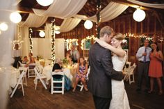 fabric draping and white lights to brighten the dark wood interior