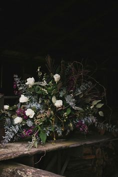 A Unique Boutique florals by Taryn Baxter - http://www.lindseybrunk.com/blog/2014/10/17/flower-crush-friday-dark-moody-florals