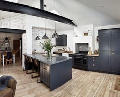 Shaker kitchen, Railings, dark units, exposed brick, white-washed brick, diy-kitchens, oak worktops, exposed RSJ, Helmsley Bespoke, antique pine floorboards, polished concrete. See more at Insta acct: dreambound1974