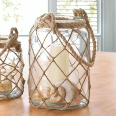 Large Fisherman Net Candle Lantern - What a catch! This large glass lantern is wrapped in fisherman net with a wrapped rope handle. Candle Lanterns, Diy Candles, Glass Candle, Glass Jars, Candle Jars, Candle Holders, Sea Glass, Mason Jar Crafts, Bottle Crafts