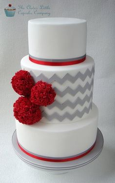 Grey chevron with red Pom poms a perfect winter #wedding cake i like this but with yellow flowers