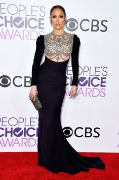 Jennifer Lopez in a Reem Acra dress, Brian Atwood shoes, and H. Stern jewelry.