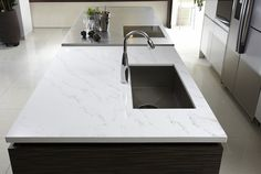 Hanstone Tranquility a Quartz alternative to marble? Cheaper (not sure how much), much more durable, lifetime warranty, less maintenance. Also see Frosty Carrina or Santa Margherita Victoria.