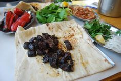 Eating Dalak in Urfa. Dalak is the spleen of an animal. The best way to eat it is well done and grilled over a high flame