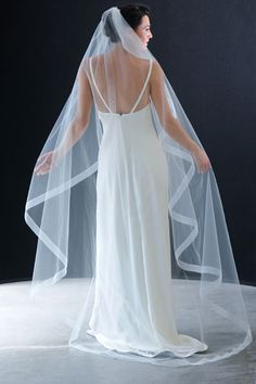 Erica Koesler 796-80. 80″ (80″) Flutter cut with 1 1/2″ organza ribbon edge gathered on a wire comb.