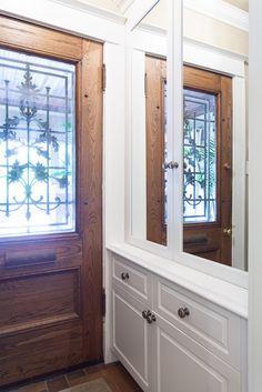 Entryway storage with mirror doors.