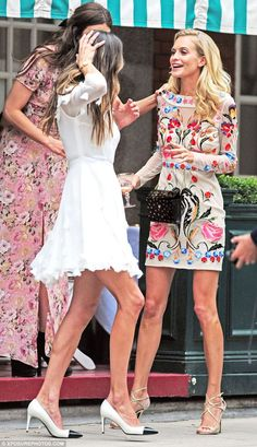 Floral delight: Poppy Delevingne wows in an elaborately embroidered dress as she partied in Mayfair, London