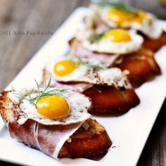 Idea* bacon wrapped toasted French bread with fried egg on top   Caramelised Fennel, Serrano Ham and Fried Quail Egg Brunch Bruschetta