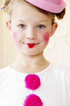 Bright cheeks and pink poms! Perfect party style.