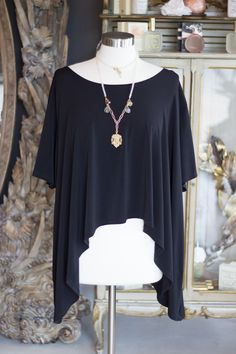 Black Knit Topper with an asymmetrical hemline. Made in the USA!