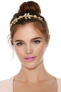 Gold floral design headband with pearl embellishment.