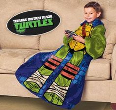 """""""Ninja Turtle"""" blanket with sleeves lets kids stay warm and cozy with """"turtle power""""! Your child will look like one of the beloved heroes in a half-shell when he or she wears this comfy, sleeved blanket. """"Ninja Turtle"""" Blanket (E7595)"""