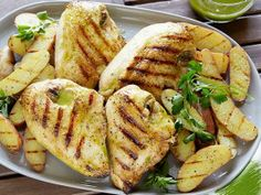 Grilled Chicken with Roasted Garlic-Oregano Vinaigrette and Grilled Fingerling Potatoes Recipe : Bobby Flay : Food Network Top Recipes, Potato Recipes, Dinner Recipes, Dinner Ideas, Recipies, Turkey Recipes, Summer Recipes, Free Recipes, Easy Recipes