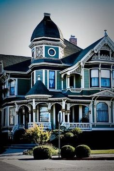 imagine light green or blue with white trim..  look at the big turret and the little porch turret in front of it!!  and that's a house that could have 'wings'.