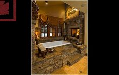 Now we're talking....massive rock bath with fireplace soaring at the end of it!