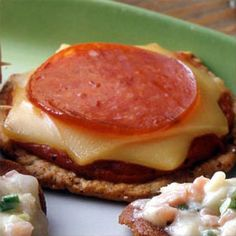Quick Snack Pizzas--we make these every now and then.  Tonight is one of those nights.  We use a BIG wheat thin for the cracker.  YUMMM!!