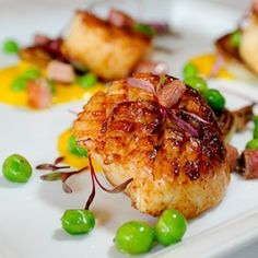 Pan-Seared Scallops with Pancetta, Peas, Cippolini Onions, Cumin-Carrot Sauce