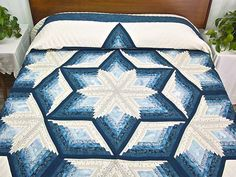 Diamond Star Log Cabin Quilt -- magnificent cleverly made Amish Quilts from Lancaster.... Reminds me of a snowflake!!