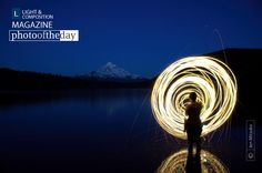 "Roar of an Uncontrolled Wheel, by Jen Mitsuko - This photograph was taken during the twilight hour in the MT. Hood National Forest, at Lost Lake. I took the photograph for my artwork series ""Capturing time"", where I sought out to capture time through photography."