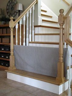 Fabric-covered PVC frame slid between railing spindles instead of a store-bought safety gate. Easy, cheap and customizable!