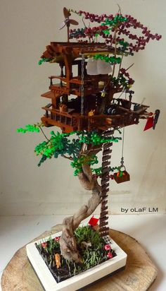 https://flic.kr/p/zyaRMg | Into The Trees | Original creation included real bonzai and Lego parts totally dissociated from the tree.