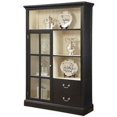 "Wood display cabinet with 3 open shelves and 1 glass paneled door.   Product: Display cabinetConstruction Material: Wood and glassColor: BlackFeatures: One doorTwo drawersDimensions: 71"" H x 47"" W x 15"" D"