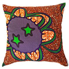 Modern with an African twist.  Shop the Atomic orange wax print pillow.