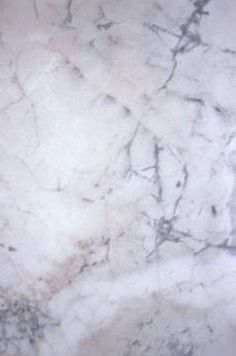 Clean carrara marble w/warm water and detergent (specifically made for marble or store-bought detergent like Dawn). Rinse with clean water and thoroughly dry with soft cloth; several times a week. Use Nothing Abrasive.   Seal 2-4 times a year w/ marble sealant. See site for polishing to remove etching, and handling stains. (Find out if it was sealed and how--some needs to be resealed every couple years, some every 15). Use nothing acidic like vinegar or lemon.