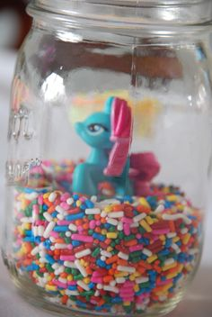This would be a cute decoration for a table at a My Little Pony birthday party, but I'd do it in a shallow bowl with several small figurines.