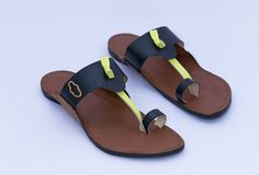 Tan brown buff leather base with black uppers and a refreshing neon yellow string