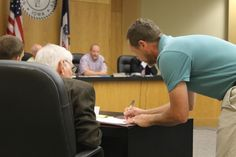 Brant Lemer (right), owner of Creastview Motor Home Park, confers with his attorney during the July 5 Story County Board of Health meeting in Nevada. Photo by Austin Harrington/Ames Tribune http://www.amestrib.com/news/crestview-motor-home-park-remain-open