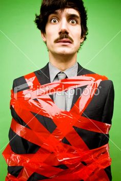 Businessman Tied Up in Red Tape Royalty Free Stock Photo