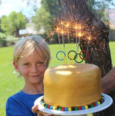 Sparklers! -- simply stated gold Olympic cake