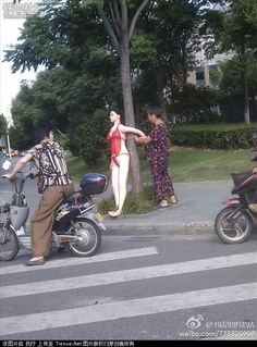Photo of the Day: Chinese Grandmother Uses Sex Doll to Slow Traffic