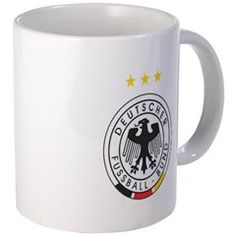 """deutscher fussball bund Mugs!  Small measures 3.75"""" tall, 3"""" diameter; Mega measures 4.5"""" tall, 3.75"""" diameter Small holds 11 oz.; Mega holds 20 oz. Black color-changing mugs available in small only and are heat sensitive. Simply add any hot liquid to the mug and see the mug turn from black to white with your unique design. Dishwasher and microwave safe"""