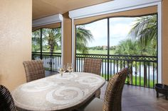 Screened lanai with a great second floor view. Impact Resistant Doors, Impact Resistant Windows, Shutters Electric.
