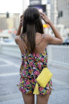 Great for daytime exploring. A lightweight, colorful romper a small, brightly colored crossbody.