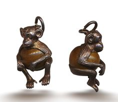 Silver charm of a Touch Wood Monkey