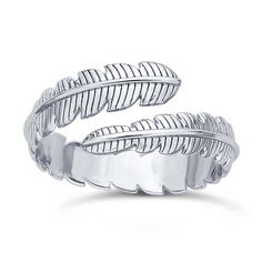Sterling Silver Feather Bypass Ring This sterling silver bypass ring features a detailed feather. The bypass design creates a wrapped look and usually allows a bit of leeway for small sizing adjustments Silver For Jewelry Making, Gold Jewelry, Jewelry Rings, Unique Jewelry, Jewellery, Rio Grande Jewelry, Bypass Ring, Jewelry Making Supplies, Jewelry Findings