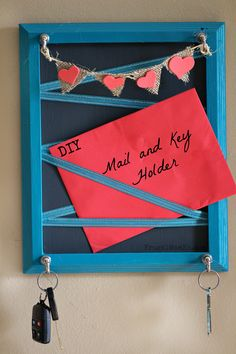 This DIY Mail and Key Holder is the key to organization in my front entryway.  Plus thanks to the bunting banner, it adds a nice touch to your home decor!