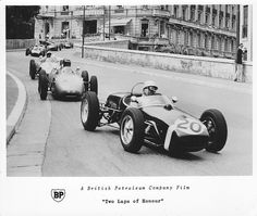 Stirling Moss leading the pack through the complex at Monaco GP in 1960 in his race winning Lotus BP Tribute set provided by the photographer to my friend, also a photographer and film cameraman. Vintage Sports Cars, Vintage Racing, Sports Car Racing, F1 Racing, Stirling, Formula 1, Sterling Moss, F1 Lotus, Classic Race Cars