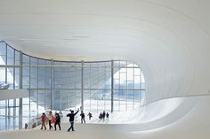 the sloping architecture is continued internally -- zaha hadid heydar aliyev center