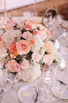Perfect flowers. Peach, coral, and blush roses; blush and cream carnations; baby's breath; cream hydrangeas; green leaves.  |  http://www.stylemepretty.com/2014/10/21/glamorous-pink-khorassan-ballroom-wedding/