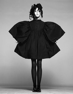 black and white fashion photography: black loose sunflower dress an floral head for a fairytale look | Penelope Tree | Fashion + Photography | Photo: Richard Avedon |