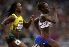 Myriam Soumare, France, leads s Veronica Campbell-Brown, Jamaica, in a women's 200-meter heat.