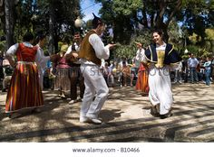 Flower Festival FUNCHAL MADEIRA Tourist crowd watching traditional costume folk dancing display Stock Photo