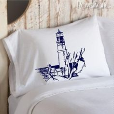 NAUTICAL LIGHTHOUSE Light House scene ART PILLOWCASE  sailor boat house cottage rocks beacon light sail Pillow case navy blue ocean view cliff sea guard grass decor deco beach room master bedroom coast vintage sailboat shabby chic gift NEW. $11.99, via Etsy.