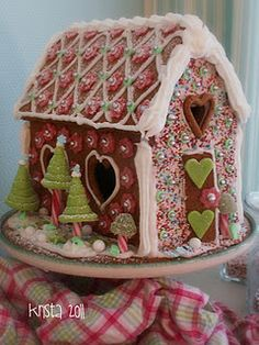Gingerbread house I like the trees with the candy cane trunks.