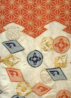 "detail of ""Kosode (Short-Sleeved Kimono) with Pine Bark Lozenges, Hemp Leaf Design, and Scattered Crests in Tie-dyeing and Embroidery on Parti-colored, Figured-Satin Ground"", 18th century, Japan.  Kyoto National Museum."